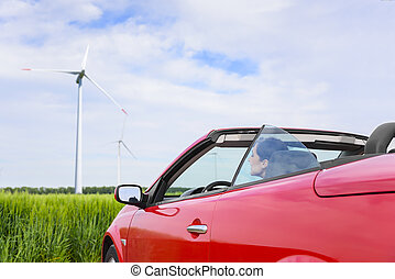 Woman in a red cabriolet in a field - Woman in a red...