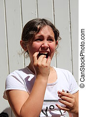 Young Girl eating Chocolate - Young girl eating chocolate in...