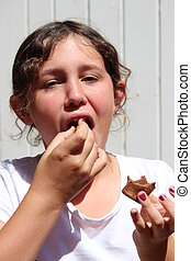 Young Girl eating Chocolate - Young girl eating chocolate...