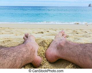 Feet on the Sandy Beach