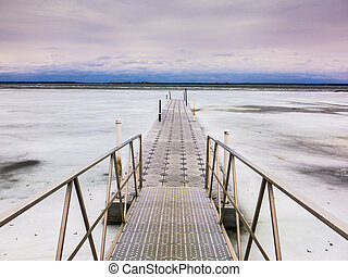 Pier into Frozen lake in Ontario