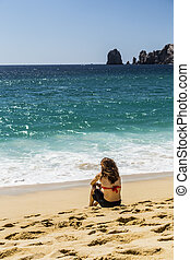 Woman Sitting in Bikini Relaxing on Sandy Beach