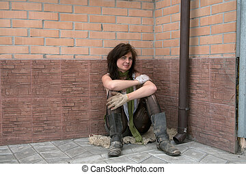 Homeless girl sits in depression