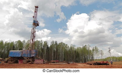Oil gas drilling rig - Timelapse clouds over drilling rig