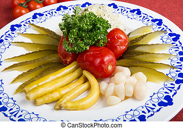 Marinated vegetables on a plate - Marinated cucumbers,...