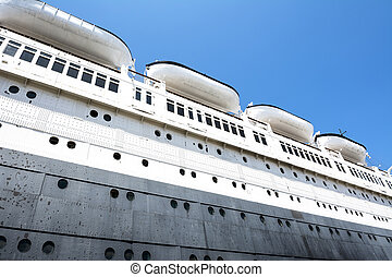Queen Mary Hull - The hull of an old cruise ship shows the...