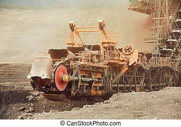 Coal mining in an open pit - Huge mining machine in the coal...