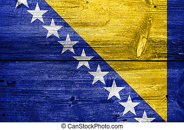 Flag of Bosnia and Herzegovina, painted on old wood plank...