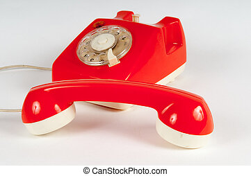 Retro orange telephone with rotary dial on white - Orange...