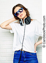 leisure with music - Modern young woman enjoys the music on...