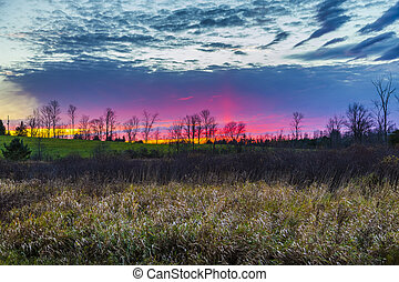 colorful rural sunset scene in late autumn