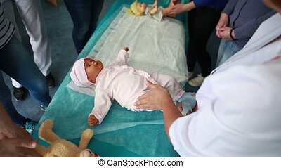 woman performing CPR on baby training doll with one hand...