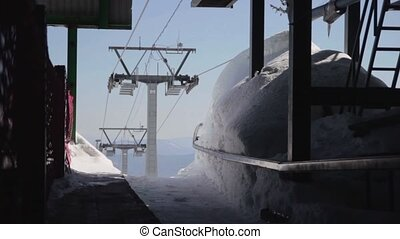 cableway - Snow forest and skiers on a ski lift pov