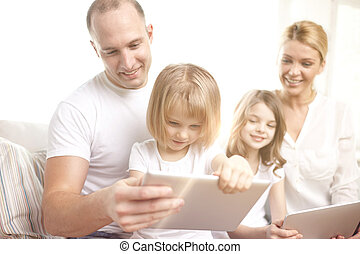 happy family with tablet pc computers at home - family,...
