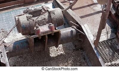 Shale shaker on oil rig separating drilling mud - Shale...