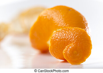 Closeup on Orange Clementines in Bright Studio