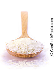 rice - uncooked rice in wooden spoon over white background