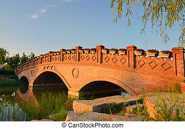 Landscape with brick arch bridg - Sunset landscape with...