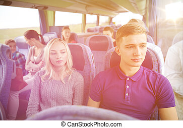 couple or passengers in travel bus - transport, tourism,...