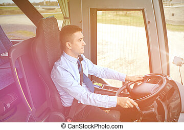 happy driver driving intercity bus - transport, tourism,...