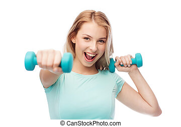 smiling beautiful young sporty woman with dumbbell -...