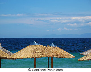 beautiful day ay the beach - parasols and the beautiful blue...