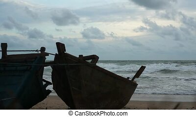 Two Wooden Boat Wrecks at the Ocean - Two wooden boat wrecks...