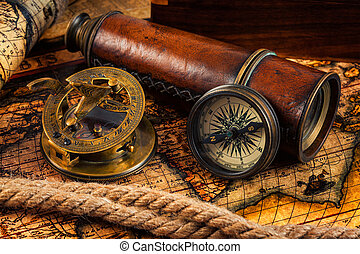 Old vintage compass and navigation instruments on ancient...