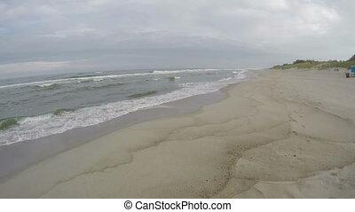 Waves crashing on seashore, 4K - Waves moving on white sand...