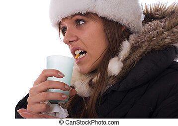 Pill in the mouth - Young woman have head cold and holding...