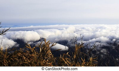 san 12 - Time lapse of clouds crossing over mountain in...