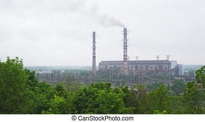 Working coal-fired power plant with high tubes and smoke...