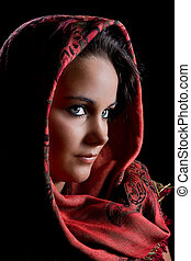 Red scarf - Low-key portrait of a young woman wearing a red...