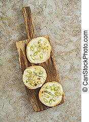 Mini tarte flambee - Three mini green asparagus tarte...