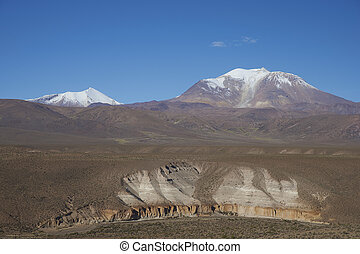 Volcano on the Altiplano of Chile - Snow covered Guallatiri...