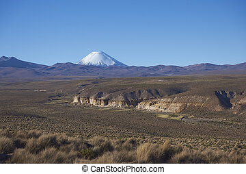 Volcano on the Altiplano of Chile - Snow covered peak of...