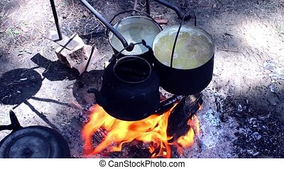 cooking on a fire in the campaign