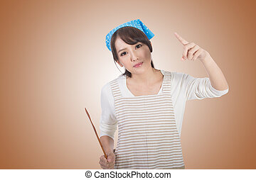 Mad Asian housewife, closeup portrait