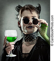 goth-style man with absinthe glass  photo