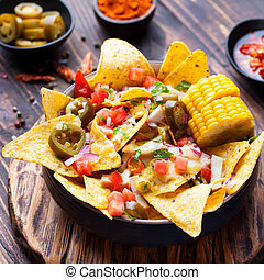 Nachos with melted cheese sauce, salsa, corn cobs - Nachos...