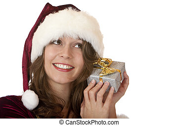 Young happy woman with Santa costume holds Christmas gift -...
