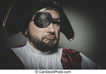 Angry man pirate with eye patch and old hat with funny faces...