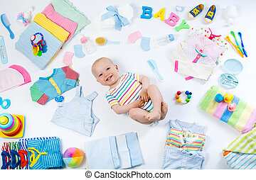 Baby with clothing and infant care items - Baby on white...