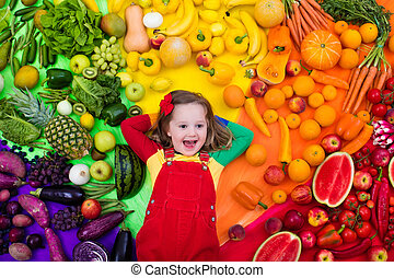 Healthy fruit and vegetable nutrition for kids - Little girl...