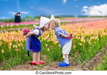 Dutch children in tulip field - Happy Dutch children playing...