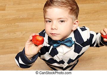 boy four years, bitten strawberry - The little handsome boy...