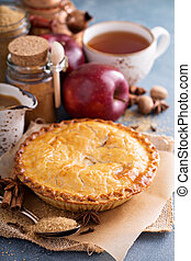 Apple pie with caramel syrup and cinnamon