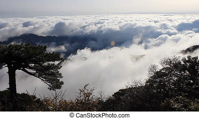 san 17 - clouds crossing over mountain in China.