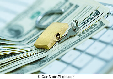 Security lock on dollar bills with white computer keyboard -...