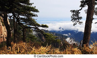 san 19 - clouds crossing over mountain in China.